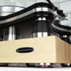 """IsoAcoustics' Delos """"Butcher Block"""" isolation platform for turntables and electronics."""